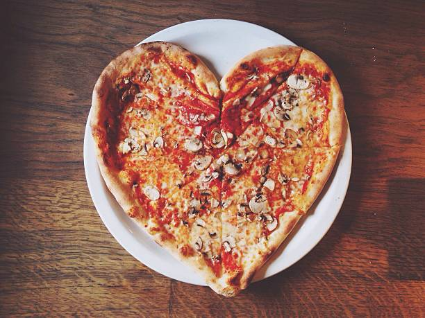 Close-up Overhead View Of Heart Shape Pizza Wall Art