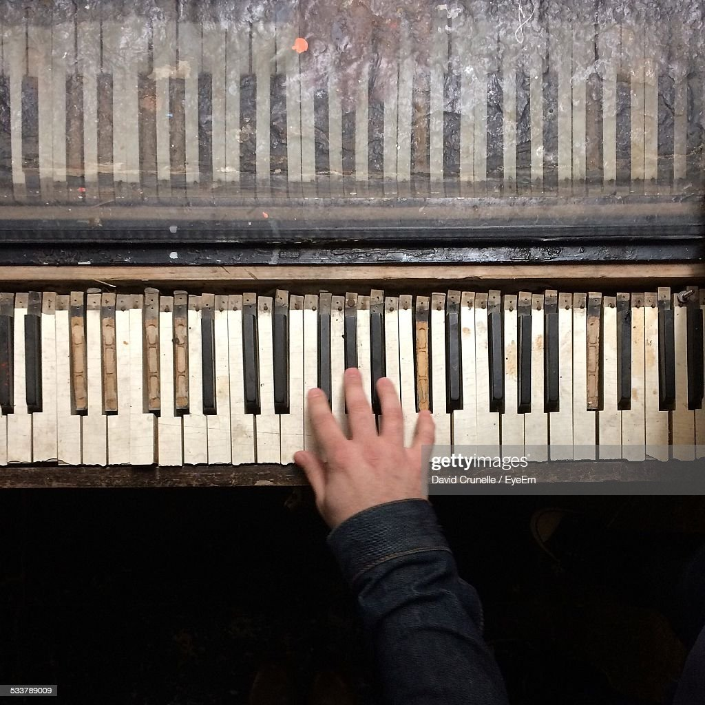 Close-Up Person Hand Playing Piano : Foto stock