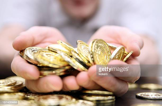 Close-up photo of a handful of gold coins