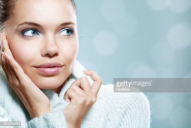 Close-up photo of a woman in a cozy sweater