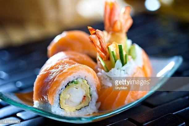 close-up photo of futomaki sushi on a blue plate - maki sushi stock pictures, royalty-free photos & images