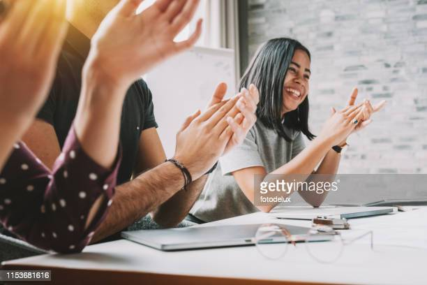 closeup photo of partners clapping hands after business seminar - achievement stock pictures, royalty-free photos & images