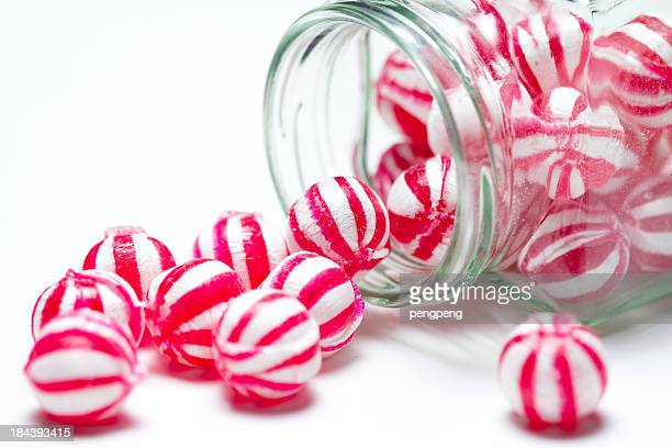 Close-up photo of red and white striped candies in a jar