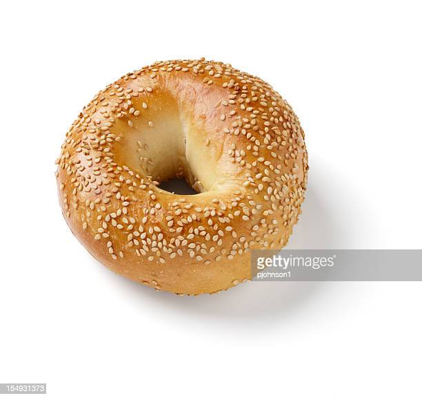 Close-up photo of sesame bagel on white background