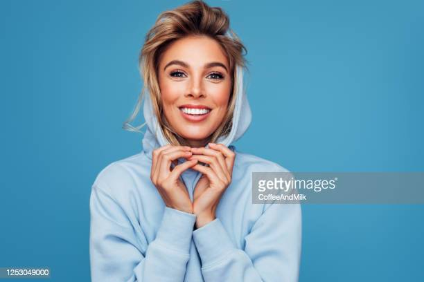 close-up photo of trendy cheerful woman wearing hoody - sportswear stock pictures, royalty-free photos & images