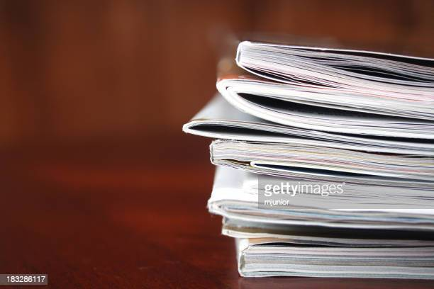 Close-up photograph of a stack of magazines