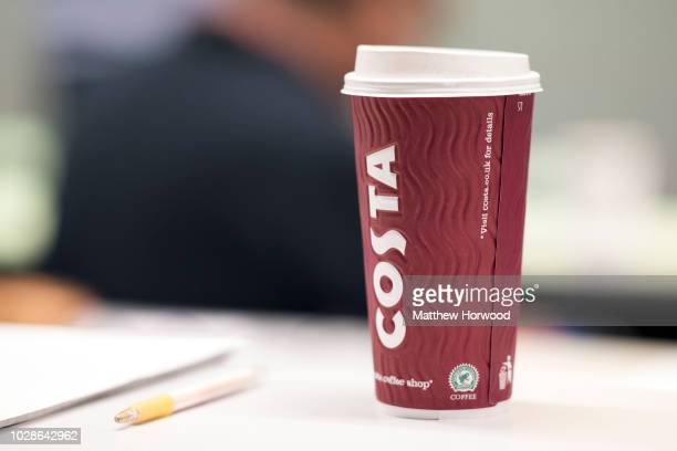 A closeup picture of a Costa Coffee cup on January 23 2018 in Cardiff United Kingdom Costa Coffee owner Whitbread which also owns the Premier Inn...