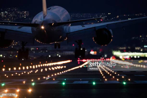 Close-up picture of the back of the airplane arriving at the airport.