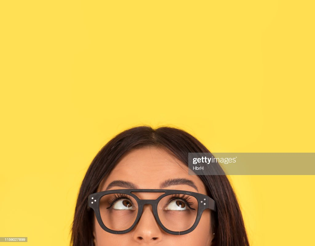 closeup portrait headshot cute happy woman in glasses looking up : Stock Photo