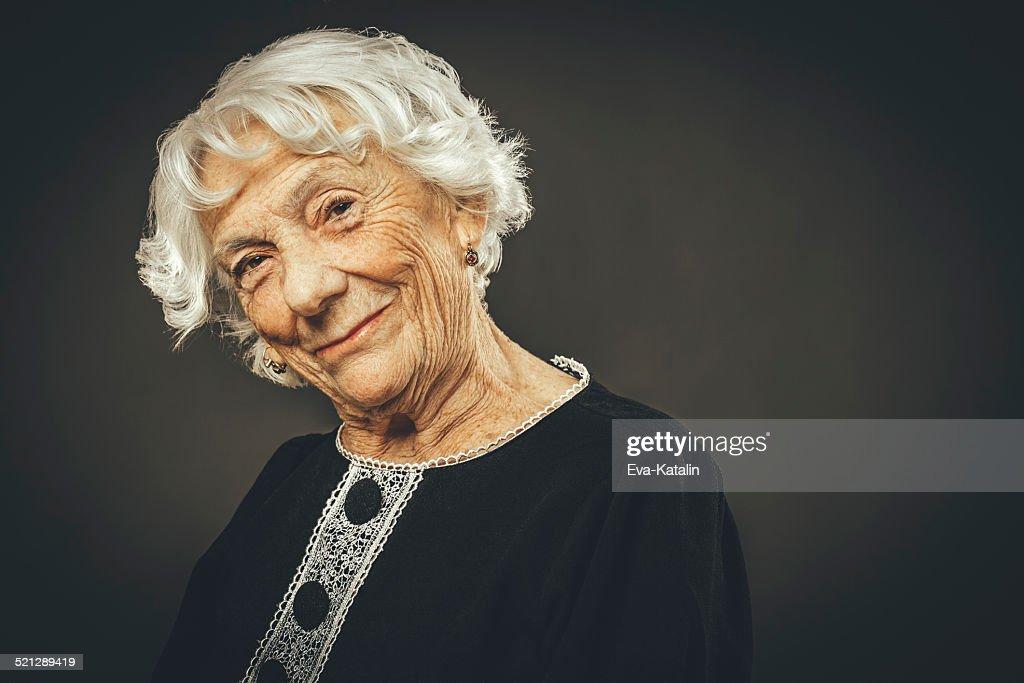 Close-up portrait of a beautiful senior lady : Stock Photo