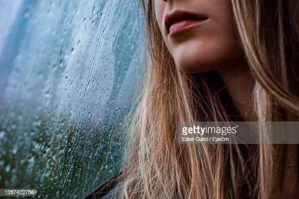 close-up portrait of a beautiful woman in rainy day - damp lips stock pictures, royalty-free photos & images