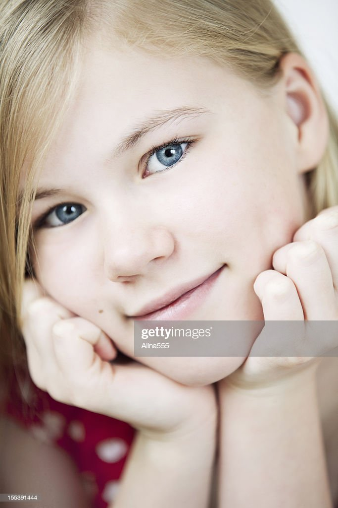 11 Year Old Blonde Girl: Closeup Portrait Of A Cute 11year Old Girl Stock Photo
