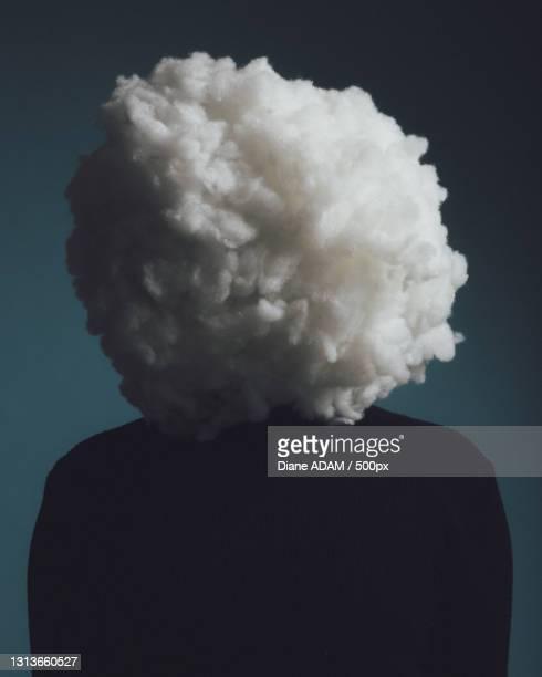 close-up portrait of a man in a studio with cotton covering face representing a cloud,paris,france - tête composition photos et images de collection