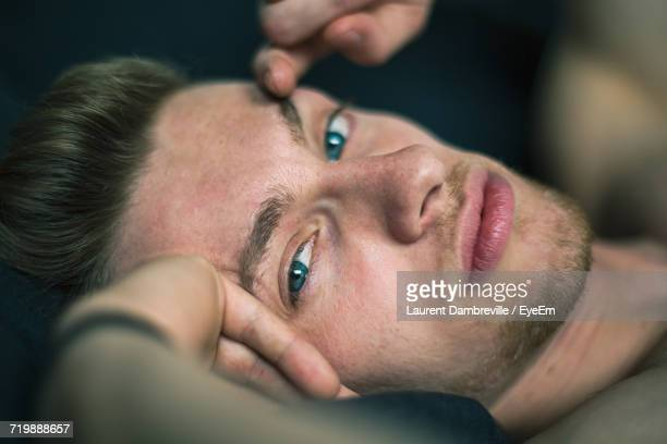 Close-Up Portrait Of A Man Lying Down