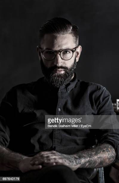 close-up portrait of a man - dark clothes stock photos and pictures