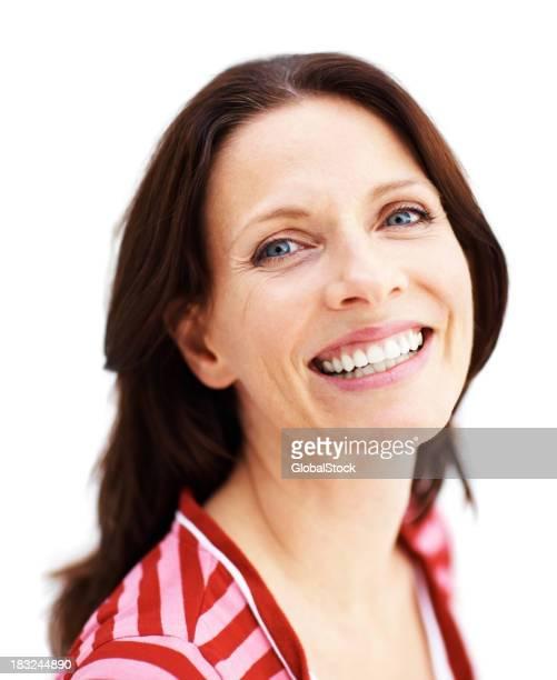 Closeup portrait of a mature female smiling against white