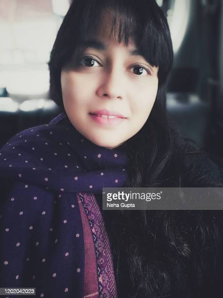 closeup portrait of a millennial woman - the back seat of a car. - neha gupta stock pictures, royalty-free photos & images