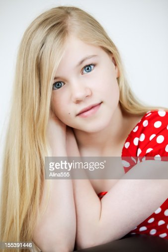 closeup portrait of a serious 11year old girl stock photo. Black Bedroom Furniture Sets. Home Design Ideas