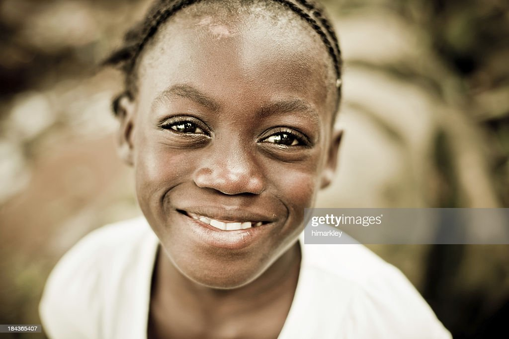 Close-up portrait of a smiling girl : Stock Photo