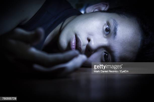 close-up portrait of a teenage girl in the dark - dead body stock-fotos und bilder