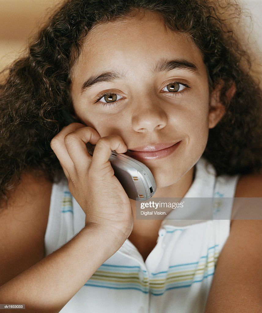 Close-up Portrait of a Young Girl Using a Mobile Phone : Stock Photo