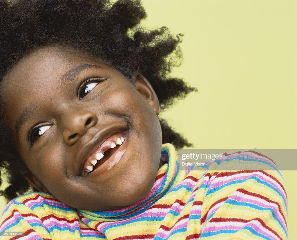 Close-Up Portrait of a Young Girl With Gappy Teeth : Stock Photo