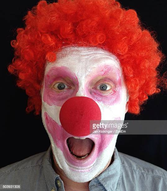 close-up portrait of a young man dressed as a clown - clown's nose stock photos and pictures
