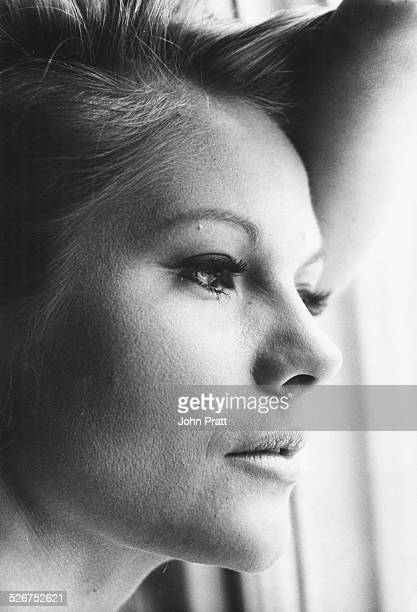Closeup portrait of actress Anna Palk gazing out of the window of her Belgrave home London circa 1965
