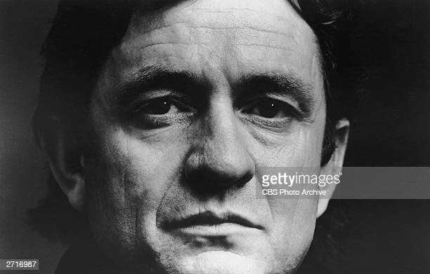 Closeup portrait of American country singer and songwriter Johnny Cash