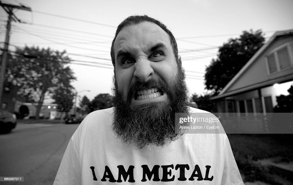 Close-Up Portrait Of Angry Bearded Mature Man : Stock Photo