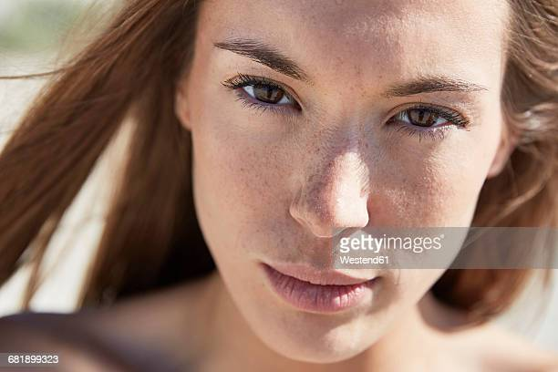 Close-up portrait of attractive young woman outdoors