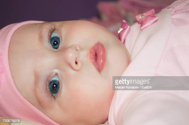 Close-Up Portrait Of Baby Girl With Blue Eyes