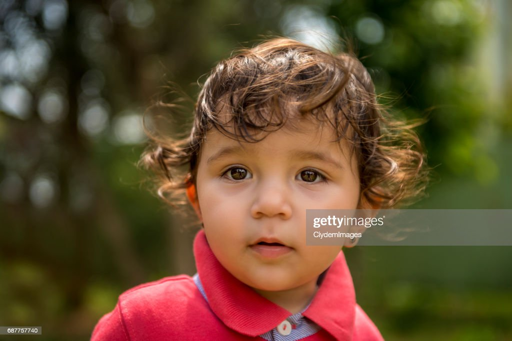Close-up portrait of baby looking away with blank expression : Stock Photo