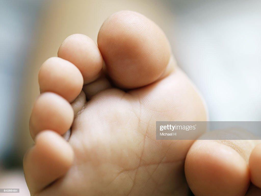 Closeup portrait of baby's foot : Stock Photo