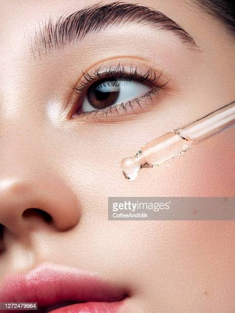 close-up portrait of beautiful girl getting skin anti aging treatment - skin care stock pictures, royalty-free photos & images
