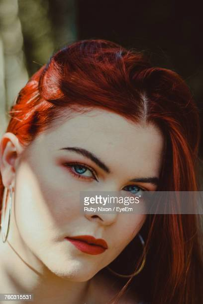 Close-Up Portrait Of Beautiful Redhead Woman With Red Lipstick