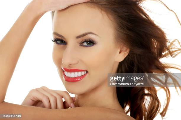 close-up portrait of beautiful smiling young woman over white background - one young woman only stock pictures, royalty-free photos & images