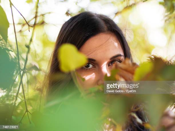 Close-Up Portrait Of Beautiful Woman Amidst Plants