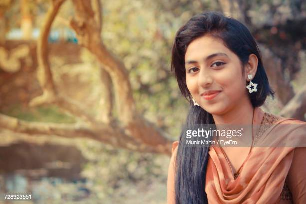 close-up portrait of beautiful woman smiling against trees - salwar kameez stock pictures, royalty-free photos & images