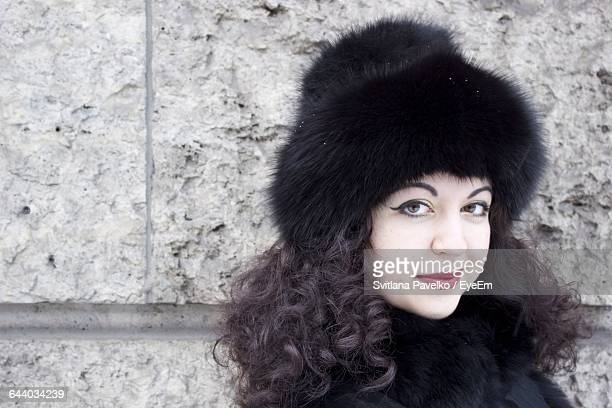 Close-Up Portrait Of Beautiful Woman Wearing Black Cap During Winter