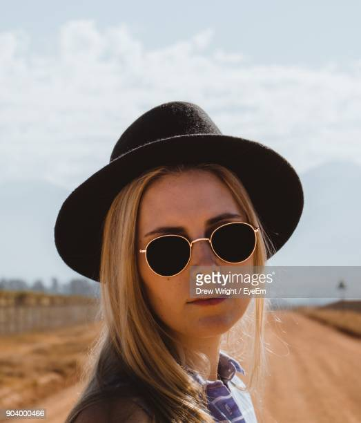 Close-Up Portrait Of Beautiful Woman Wearing Sunglasses