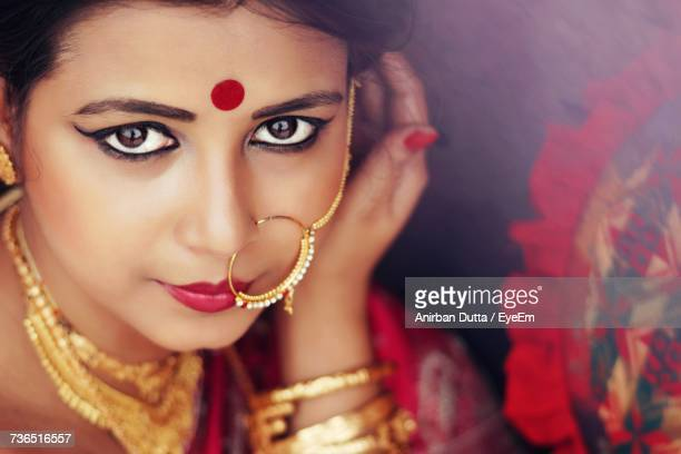 Close-Up Portrait Of Beautiful Woman Wearing Traditional Jewelry
