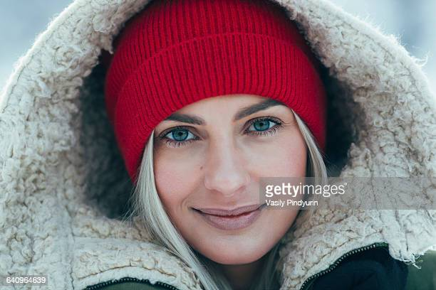 Close-up portrait of beautiful young woman wearing hood