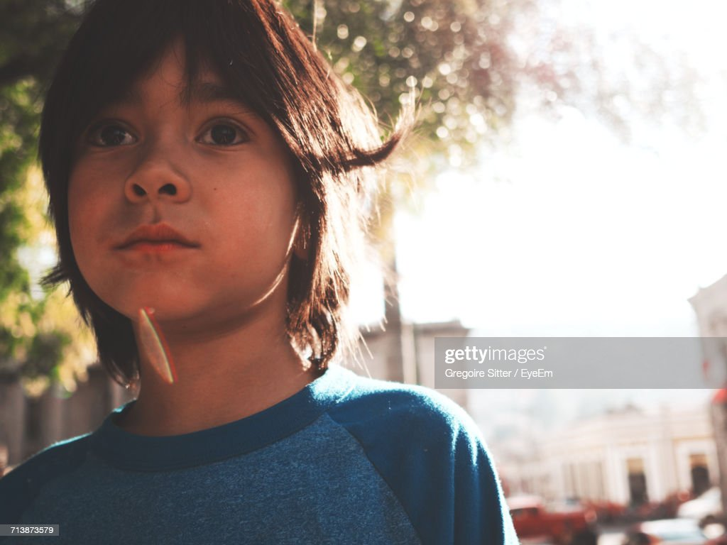 Close-Up Portrait Of Boy Against Sky : Stock Photo