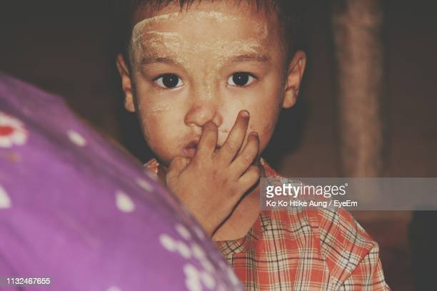 close-up portrait of boy at home - ko ko htike aung stock pictures, royalty-free photos & images