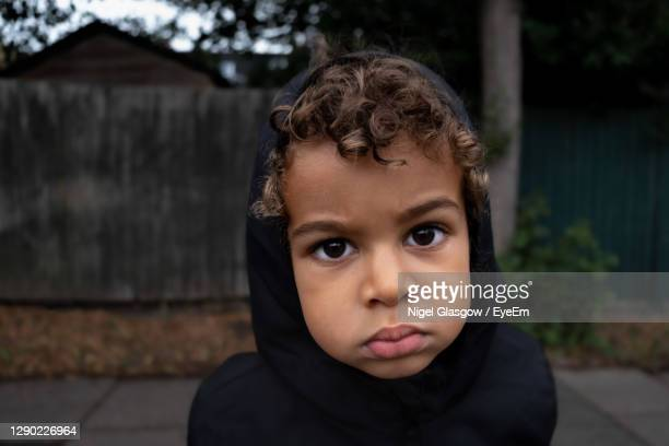 close-up portrait of boy - poverty stock pictures, royalty-free photos & images
