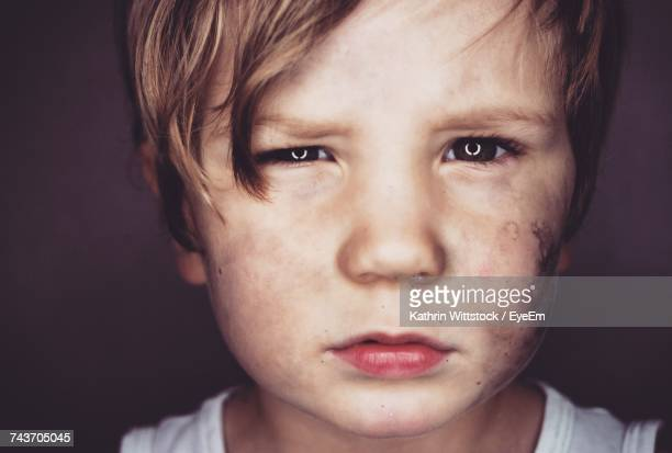 close-up portrait of boy - abused child stock photos and pictures