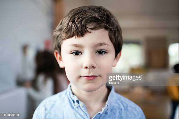 Close-up portrait of boy standing in classroom