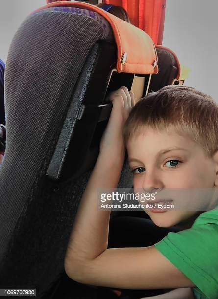 Close-Up Portrait Of Boy Traveling In Train