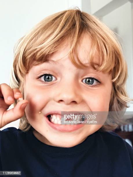 Close-Up Portrait Of Boy With Gap Toothed 14610bff01428